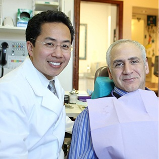 Dr. Tong and patient smiling