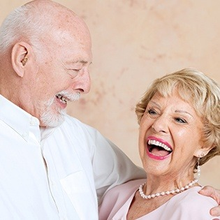Laughing older man and woman