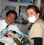 Dr. Tong treating dental patient