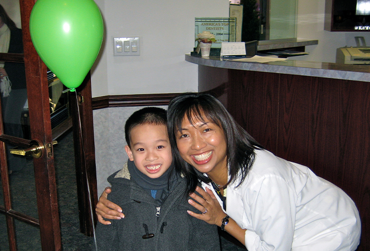 Dr. LaCap and smiling child in reception area