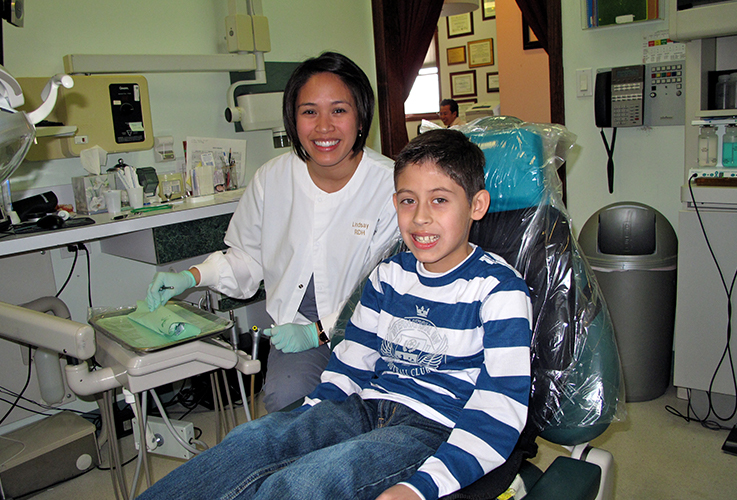 Dr. LaCap and smiling child in dental chair