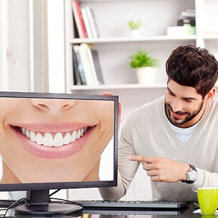 Man looking at smile design on computer