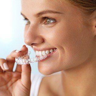 Woman placing clear aligner